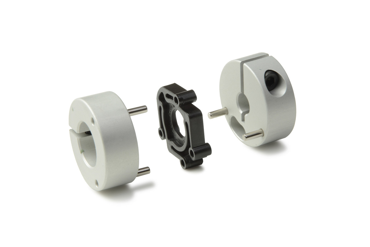 Controlflex couplings are comprised of two anodized aluminum hubs joined by pins to a Delrin insert.