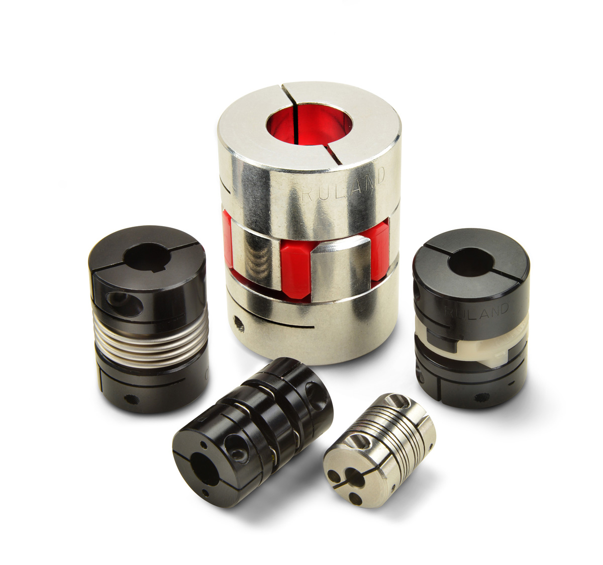 Servo couplings from Ruland: jaw coupling, oldham coupling, beam coupling, disc coupling, bellows coupling (from center clockwise)