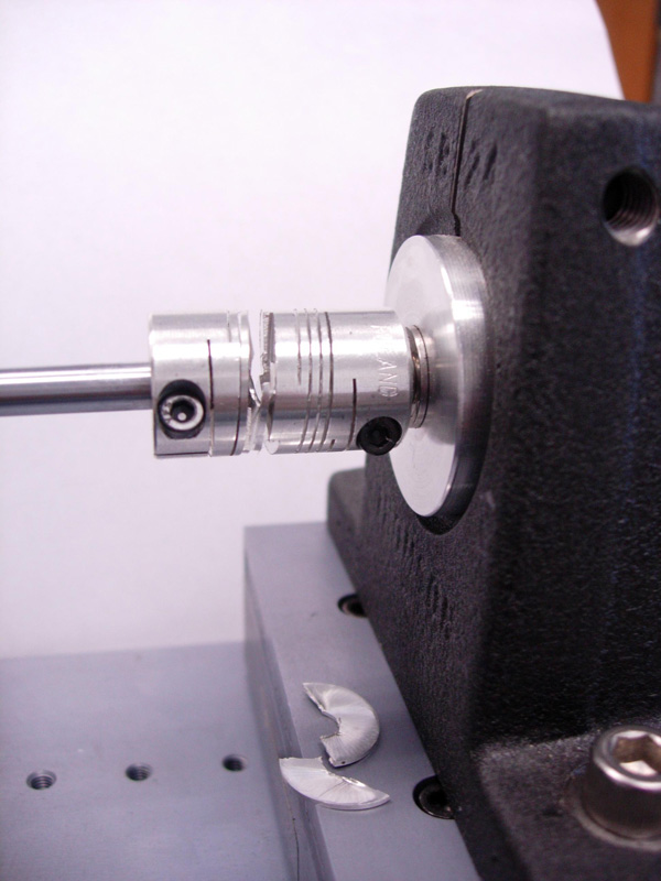 This beam coupling has failed near the center and represents what may occur in a torque overload condition. A torque in excess of the coupling design limits was applied to illustrate this example. Beam coupling failure may also occur in applications with parallel misalignment because the single beam must bend in two different directions simultaneously, creating larger stresses in the coupling that could cause premature failure.
