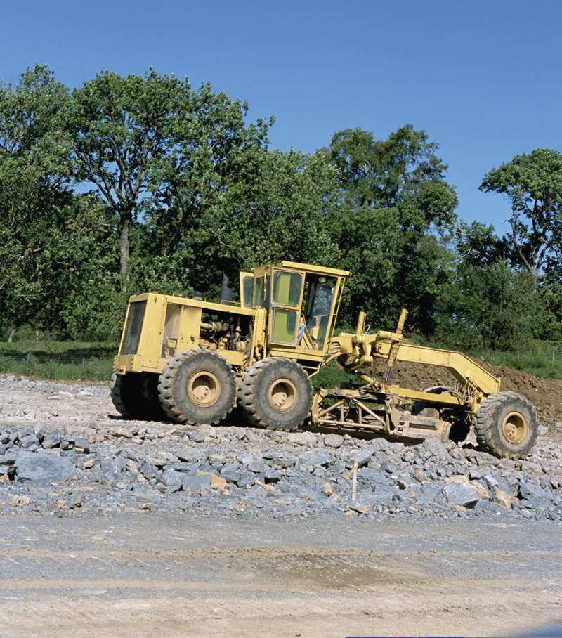 Example of a motor grader used for road construction